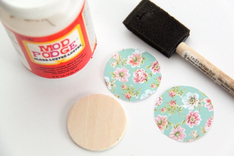 Bottle of Mod Podge wood cricle and foam paintbrush
