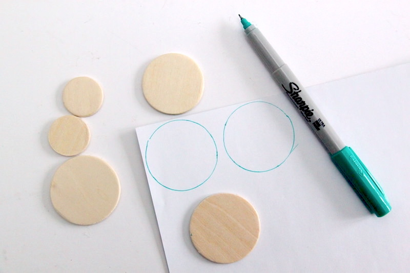 Tracing circles onto the back of a piece of scrapbook paper