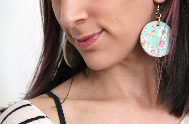 Woman wearing decoupage earrings