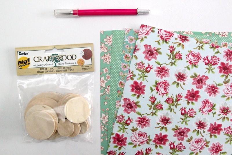 Wood circles scrapbook paper and a craft knife