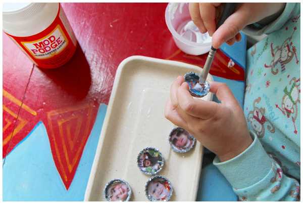 Adding a second coat of Mod Podge to bottle cap magnets