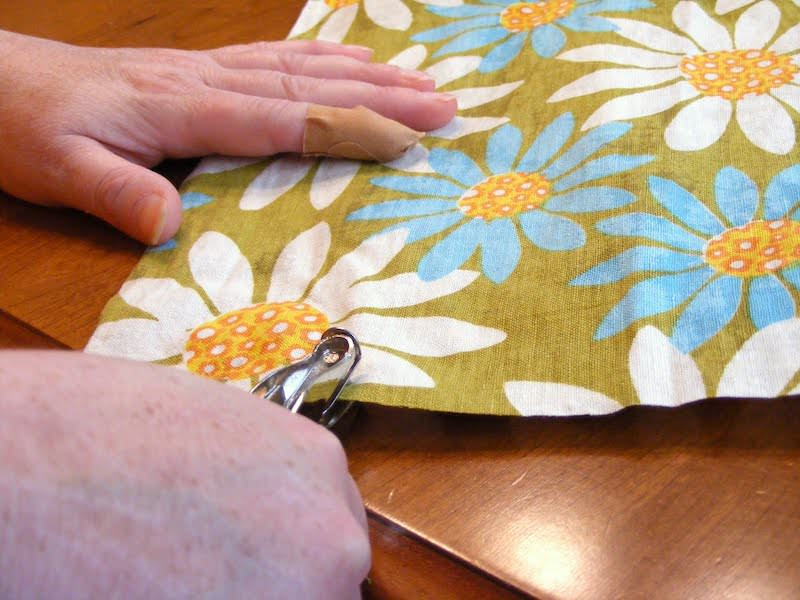 Cutting hardware areas out of fabric with a hole punch