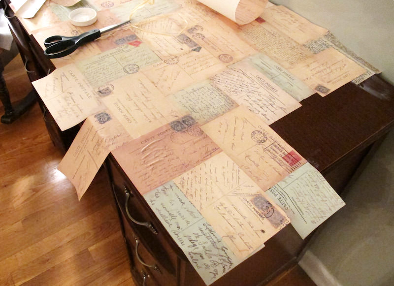 Desk with decoupage postcards on top