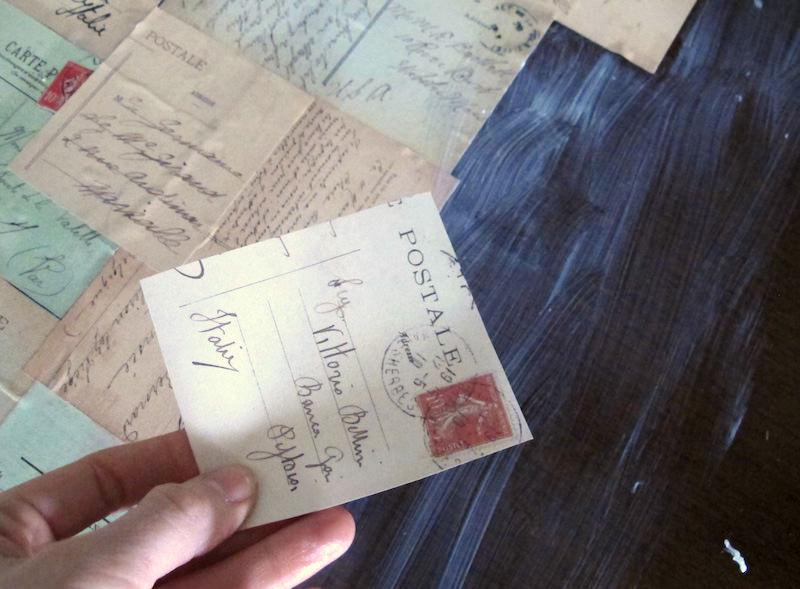 Half of a piece of postcard paper over a decoupage desk