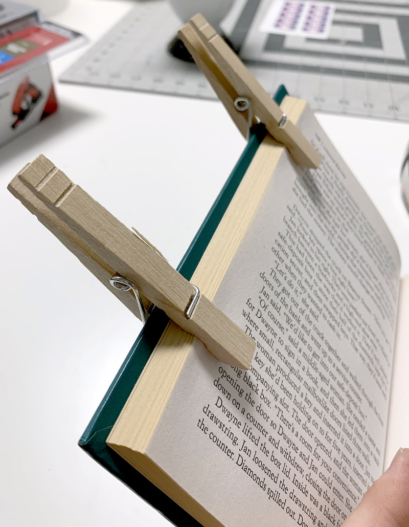 Clip the book with clothespins