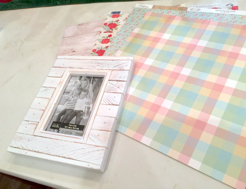 Frame-and-sheets-of-scrapbook-paper