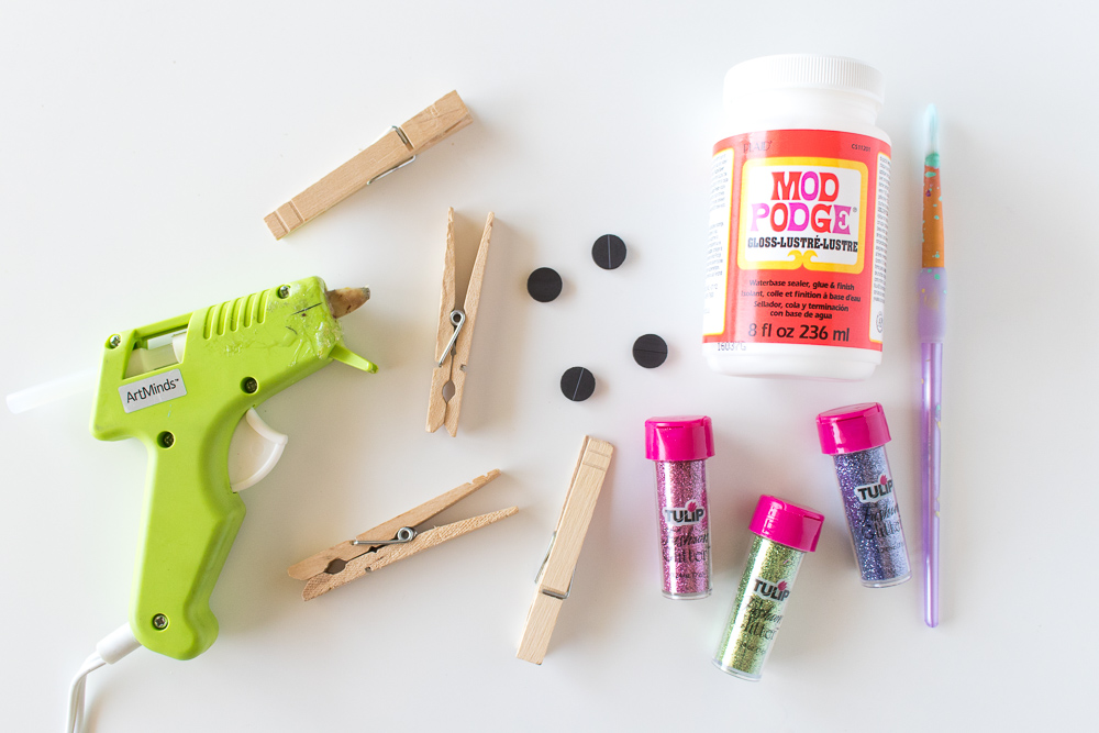 Hot glue gun, clothespins, Mod Podge Gloss, magnets, and a paintbrush