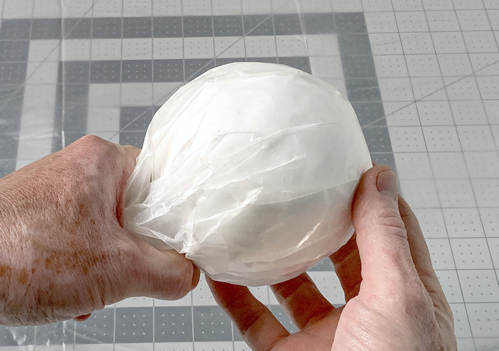 Styrofoam ball covered in wax paper