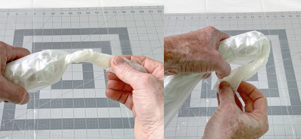 Twisting the ends of the wax paper and aluminum foil roll