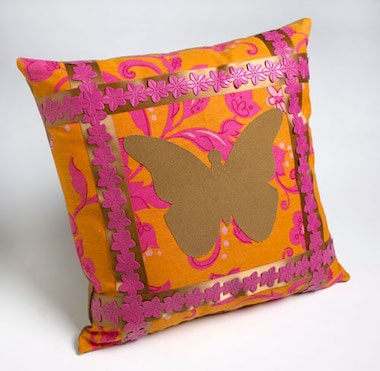 Pillow with a DIY butterfly applique done with Mod Podge